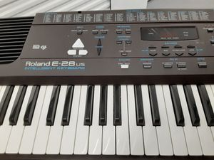 Roland E 28 Keyboard & Stand for Sale in Lutz, FL