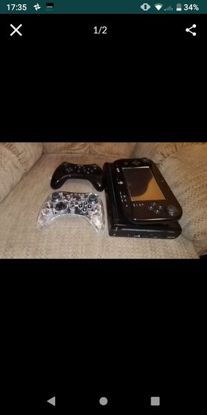 Wii u with two controllers and Wii fit board for Sale in Wauchula, FL