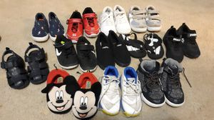 12 pairs of shoes size 6 - 7- 8. child They are not in bad shape, they just need a slight cleaning for Sale in Auburn, WA