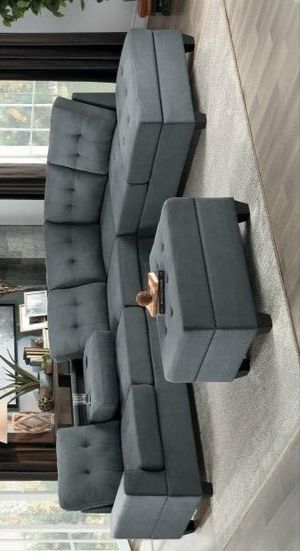 Maston dark gray sectional with ottoman for Sale in Houston, TX