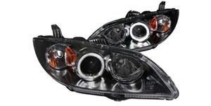 Brand new never used in original packaging. Mazda 3 CCFL HALO BLACK HOUSING PROJECTOR HEADLIGHTS for Sale in Miami, FL