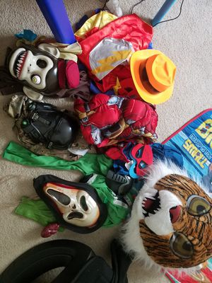 Lots of kids costumes size medium and large spiderman iron man size medium army trooper monkey circus lots of masks tiger scream eye masks for Sale in Manassas Park, VA