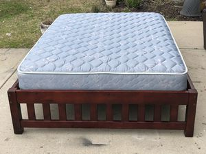 Full Size Bed with Mahogany Frame and Mattress. Excellent condition. Delivery available. Hablar espanol for Sale in Raleigh, NC
