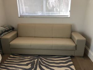 Futon Sofa. Leather looking. Beige. Perfect condition. for Sale in Deerfield Beach, FL