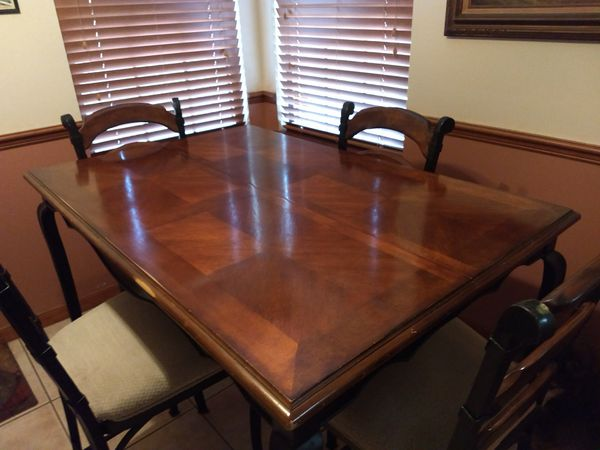 Pub Table 53X53 with Leif inserted 53X35 without has four cushioned chairs