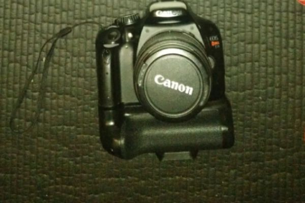 Canon T2i with 18-55 mm lens and two other lenses and Battery grip with two batteries and Magic Lantern software hack