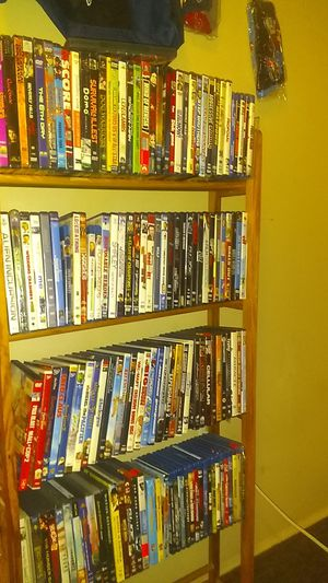 I have a movie stand 60 movies left for Sale in Waterbury, CT