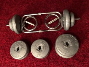 Weight set. Multi grip barbell with 10 plates for Sale in Chelmsford, MA