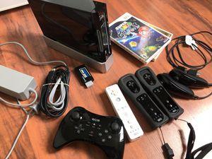 Black Nintendo Wii 2 controllers Super Mario Galaxy & Zelda Skyward Sword & Wii U Pro Controller for Sale in Miami, FL