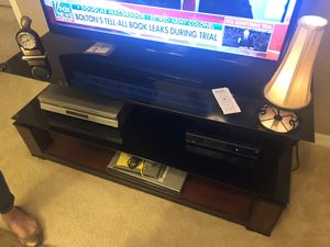 Glass and wood entertainment center television for Sale in Land O Lakes, FL