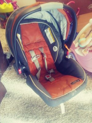 Boys orange and black car seat for Sale in Erie, PA