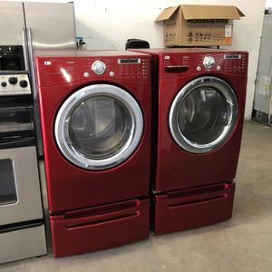 LG WASHER AND DRYER WITH PEDESTAL COLOR RED for Sale in Hialeah, FL