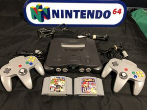 Nintendo 64 N64 Complete, Two Grey Controllers, Mario Kart 64 & Super Smash Bros. Game Paks (Trade or Buy) for Sale in Renton, WA