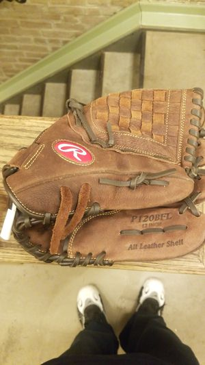 Leather Rawlings 12 Inch Left handed Baseball Glove. Get somebody into this glove and onto the field lol. All leather never used for Sale in New York, NY