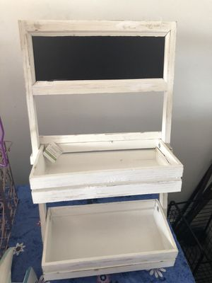 Wooden 2 tier plant stand with chalkboard a bit wobbly but does the job I used it to put bag of small Chips for sweet tables. for Sale in Schiller Park, IL