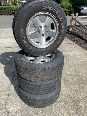 Stock Jeep Liberty wheels with tires for Sale in Tacoma, WA