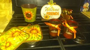 Sun flower kitchen set 2 kitchen curtains. 2 pot holders. A sunflower wreath and long stem artificial long stem sunflower and also some decoration for Sale in Providence, RI