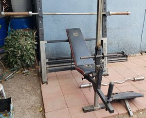 Gold's gym bench press squat rack Olympic bar weights stand for Sale in San Bernardino, CA