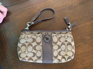 Coach brown signature C wristlet for Sale in West Haven, CT