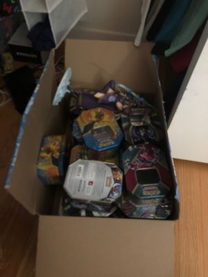Bunch of Pokémon tins, mini figures, etc. I am giving these away for free first come first serve and you must come to me I will not go to you. Thanks for Sale in Wilmette, IL