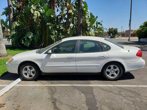 Ford Taurus 4 door white ( needs water pump ) for Sale in La Verne, CA