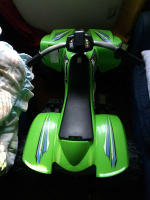 Kawasaki lime green four wheeler, with charger and battery, in great conditions for Sale in Hartford, CT
