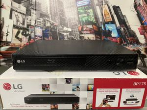 LG Blu-ray Disc/DVD player with Original DVDs for Sale in Brooklyn, NY