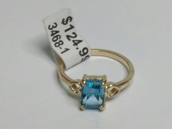 $124.99 - 2.7 gram, 14k Gold w blue stone, size 7 1/4 ring