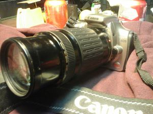 CANON EOS REBEL WITH PROMASTER SPECTRUM 7 TELECONVERTER, 1.7X AND A 75- 300 MM ZOOM LENS.. BEST DEAL IN TOWN..... for Sale in Colton, CA