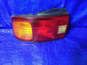 OEM 1992 1993 1994 1995 MAZDA PROTEGE DRIVER LEFT TAIL LIGHT PART # 220 61600 for Sale in Miami Gardens, FL