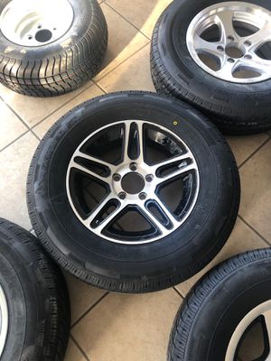 """Trailer tire. 15"""" 5 lug. 205/75/15 radial. New warranty. We will install for free. Trailer tires with aluminum rims for Sale in Dover, FL"""