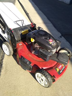 lawn mower Toro 6. 75 149cc automatic front-wheel drive still in great shape! Needs maintenance might need a spark plug or a fuel filter for Sale in Montclair, CA