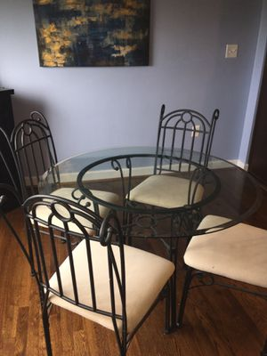 Glass top dining room table with black base and 4 chairs for Sale in Arlington, VA