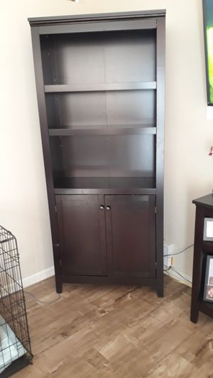 5 shelf bookcase with doors for Sale in Lynwood, CA