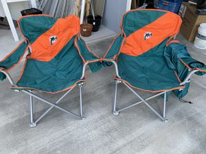 Dolphins folding chairs. Never used. . $50 both. Pick up in Jupiter for Sale in Jupiter, FL