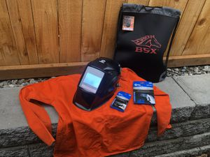Miller elite welding helmet bag and welding jacket size L for Sale in Lynnwood, WA