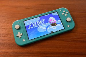 Nintendo switch lite w game for Sale in Trenton, NJ