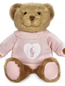 THE NEW 2021 LIMITED EDITION ROMANCE POLO BEAR BY RALPH LAUREN. THE BEAR IS BROWN WITH A PINK SWEATER. THE SWEATER HAS BOTH A WHITE HEART AND THE POL for Sale in Huntington Beach,  CA