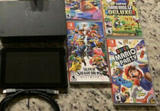 Mint Nintendo switch console with 4 games