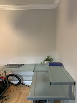 Frosted-glass corner desk with shelf by Meritline for Sale in Houston, TX