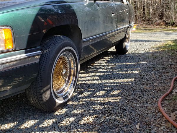 15 inch gold center FWD wire wheels with white wall tires