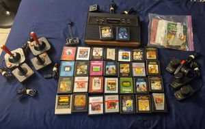 Atari 2600 with games and controllers for Sale in Phoenix, AZ