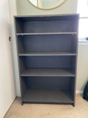Gray bookshelf for Sale in Manteca, CA