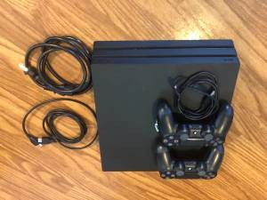 Playstation 4 video game system with 2 controllers for Sale in Wichita, KS