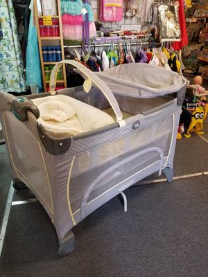 Graco Pack n Play portable crib playpen with changer, sleeper, and more! for Sale in Seattle, WA