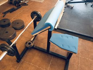 Curl bar w/ 6 weights for Sale in Sun City, AZ