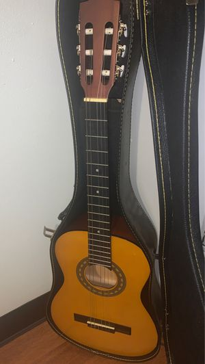 Guitar and case with handle. for Sale in Austin, TX