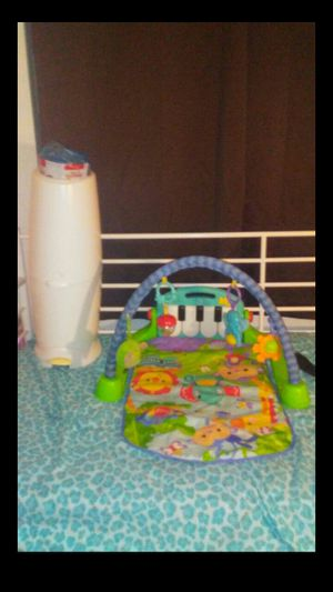 Baby stuff diaper genie with bags playmat it works all for $40 selling. Together for Sale in Tolleson, AZ