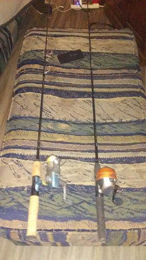 1 open face 1 close face fishing reel and rods for Sale in Wichita, KS