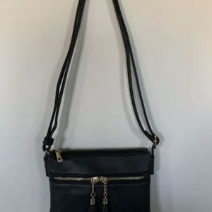 Black Crossbody Faux Gold Zipper Tassel Striped Interior 2 Main Pockets Purse for Sale in Centreville, VA
